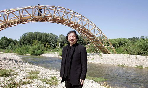 Shigeru Ban in front of his Cardboard Bridge